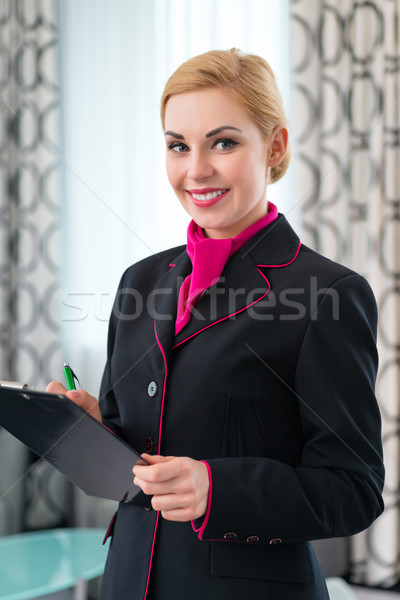 Housekeeper checking hotel suite Stock photo © Kzenon