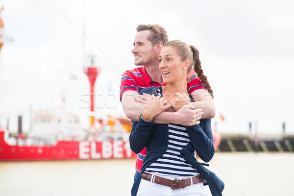 Couple hugging at Harbor pier looking at ships Stock photo © Kzenon