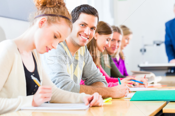 College students writing test Stock photo © Kzenon
