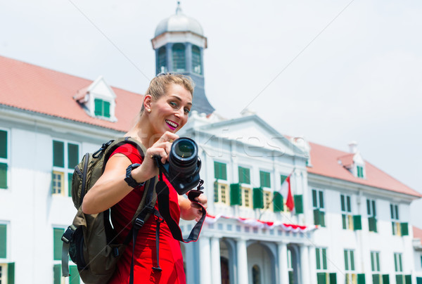 Stock photo: Tourist taking pictures sightseeing in Jakarta, Indonesia