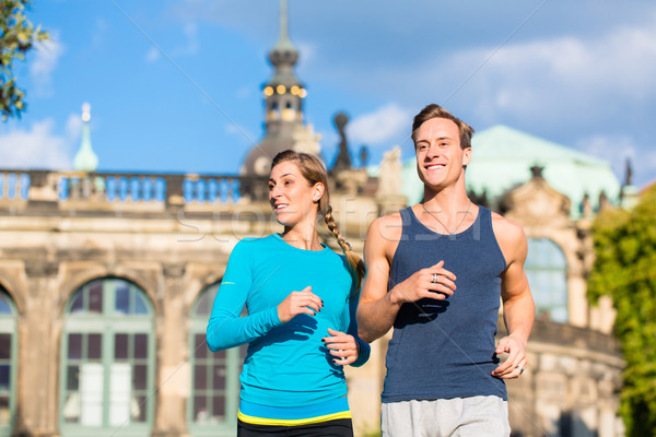 Couple running at Zwinger in Dresden Stock photo © Kzenon