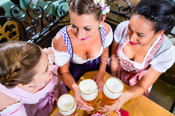 People drinking beer in Bavarian pub Stock photo © Kzenon