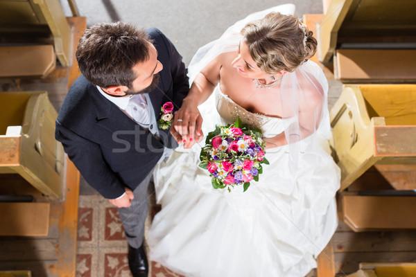 Wedding couple marrying in church Stock photo © Kzenon