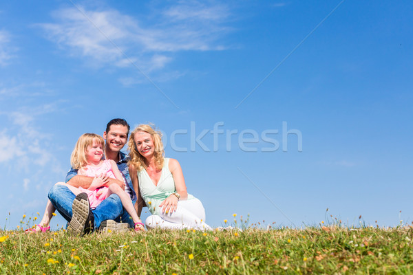 Mother, father, child, sitting in open air Stock photo © Kzenon