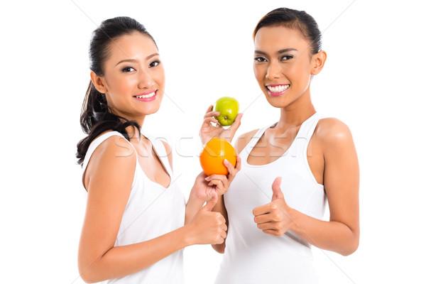 Asian friends eating fruit living healthy Stock photo © Kzenon