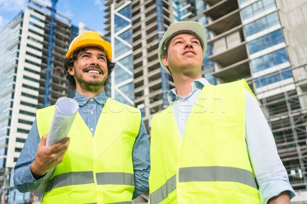 Architects supervising progress of high rise project Stock photo © Kzenon