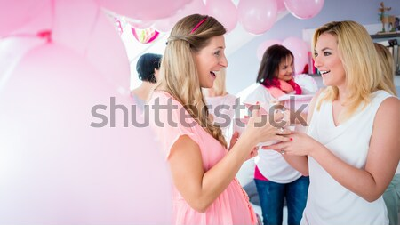 Pregnant woman opening present box on baby shower Stock photo © Kzenon