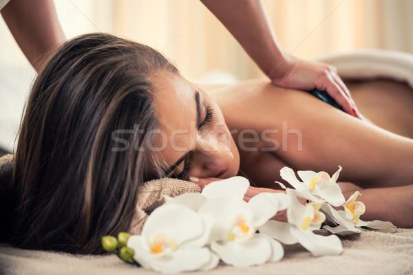 Woman enjoying the therapeutic effects of a traditional hot ston Stock photo © Kzenon