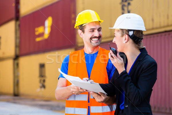 workers in logistics company discussing documents Stock photo © Kzenon