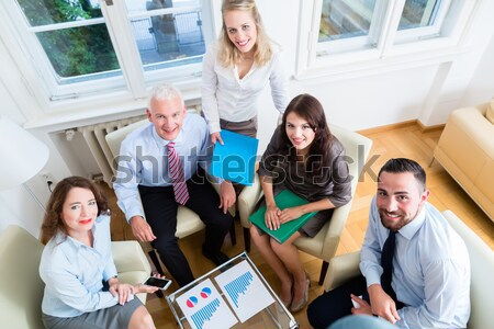 Young cheerful people showing thumbs up for co-working Stock photo © Kzenon