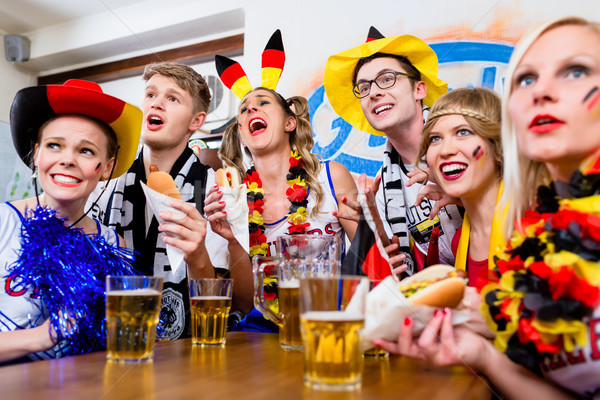 Soccer fans watching a game of the German national team Stock photo © Kzenon