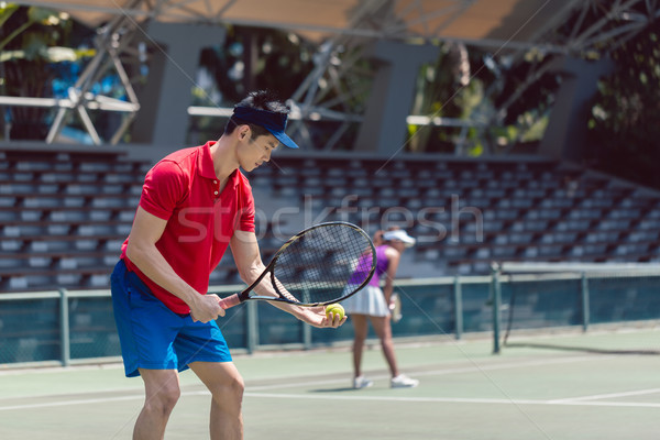 Asian tennisspeler klaar begin wedstrijd zijaanzicht Stockfoto © Kzenon