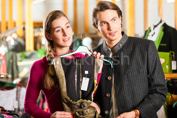 Young couple is buying Tracht or dirndl in a shop Stock photo © Kzenon