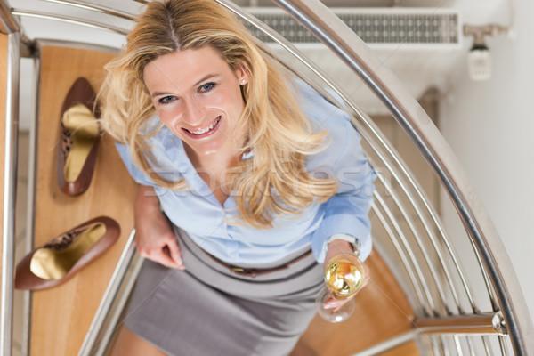Businesswoman at home with champagne Stock photo © Kzenon