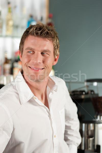 Coffeeshop - barista in his caf Stock photo © Kzenon