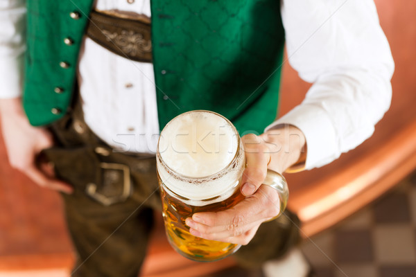 Man with beer glass in brewery Stock photo © Kzenon
