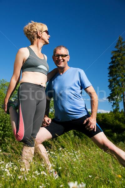 Mature couple doing sport outdoors Stock photo © Kzenon