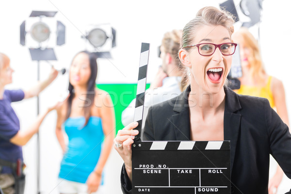 Woman with take clap at video production on film set Stock photo © Kzenon