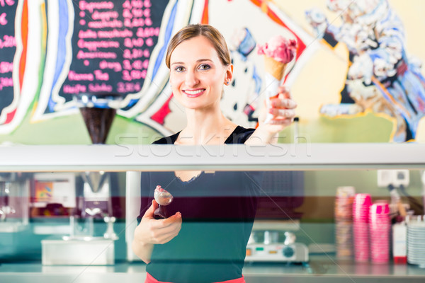 Eladó lány ostya fagylalt pult fagylalt Stock fotó © Kzenon