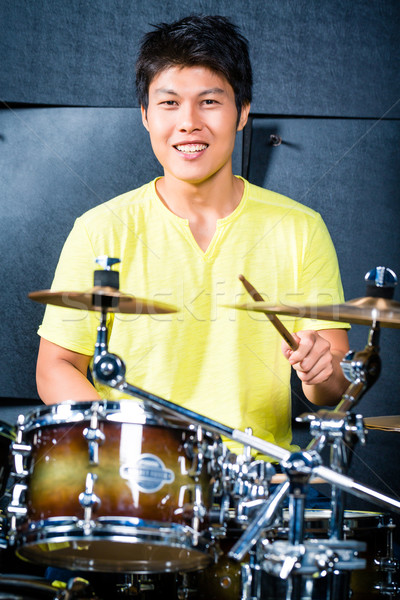Asian musician drummer in recording studio Stock photo © Kzenon