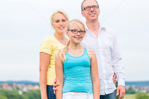 Family standing on grass of lawn or field Stock photo © Kzenon