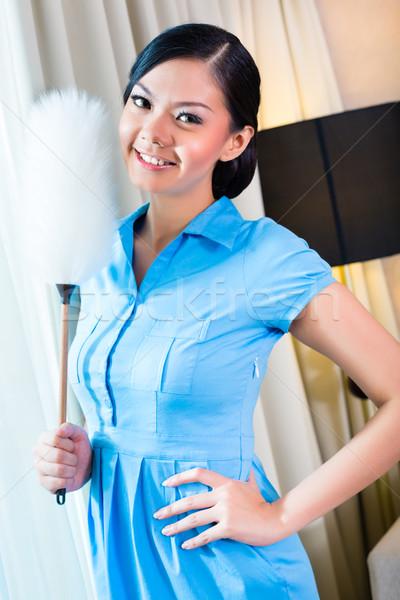Chambermaid dusting in Asian hotel room Stock photo © Kzenon