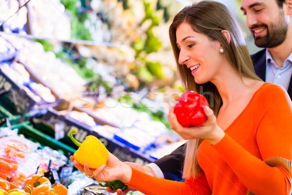 Couple selecting vegetables in hypermarket Stock photo © Kzenon