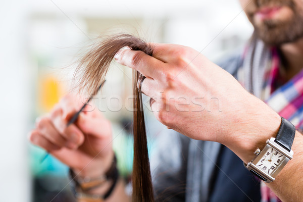 Male hairdresser cutting woman hair in hairdresser shop Stock photo © Kzenon