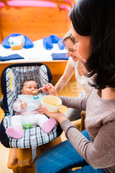 Stock photo: Mother feeding baby at midwife practice