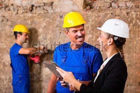 Architecte travailleur de la construction plan plan bâtiment Photo stock © Kzenon