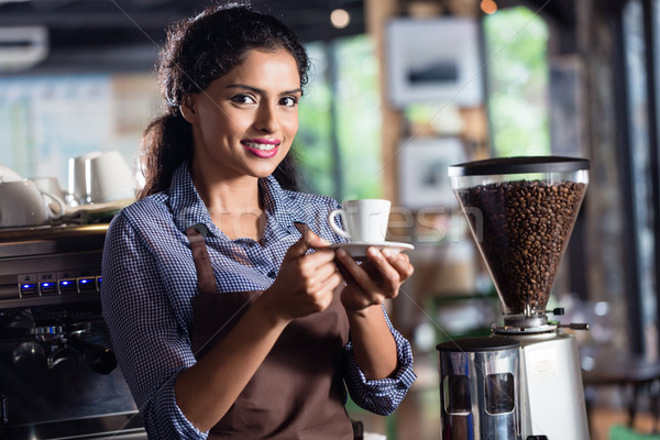 Indian barista offering coffee Stock photo © Kzenon