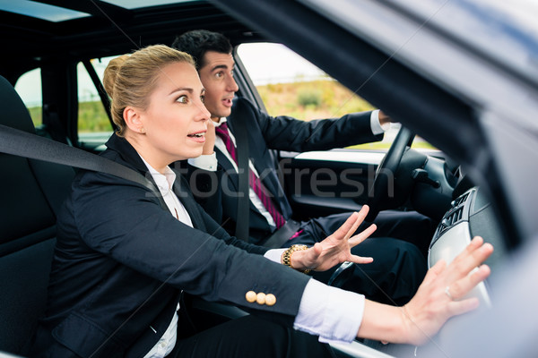 Couple in car in dangerous situation Stock photo © Kzenon