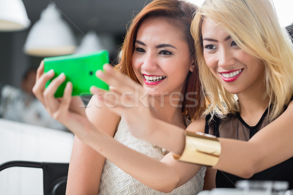 Two elegant Asian women posing for a selfie Stock photo © Kzenon