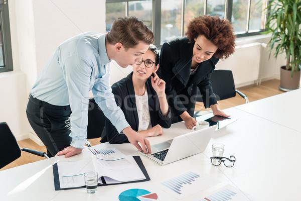 Drie jonge professionele team moderne Stockfoto © Kzenon