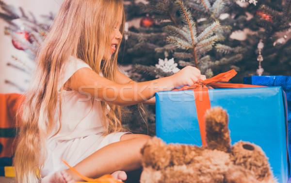 Stock photo: Child opening Christmas presents
