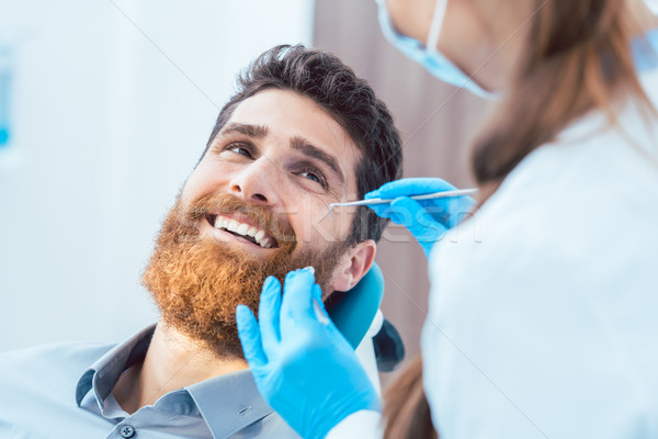 Reliable dentist using sterile instruments while cleaning the te Stock photo © Kzenon