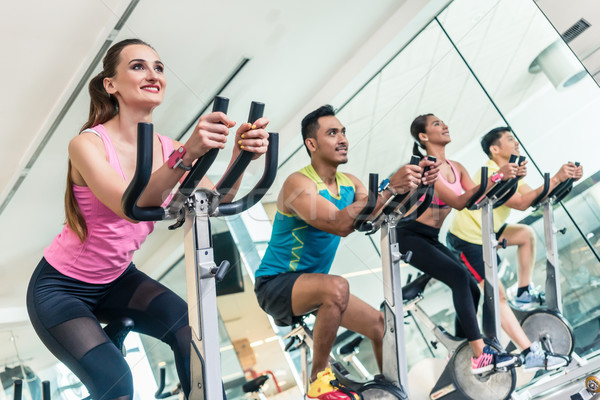 Belo caber mulher sorrindo cardio exercício vista lateral Foto stock © Kzenon