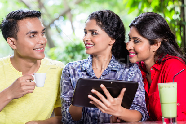 Group of young Indians looking at tablet computer Stock photo © Kzenon