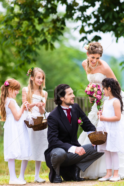 Bridal couple at wedding with bridesmaid children Stock photo © Kzenon