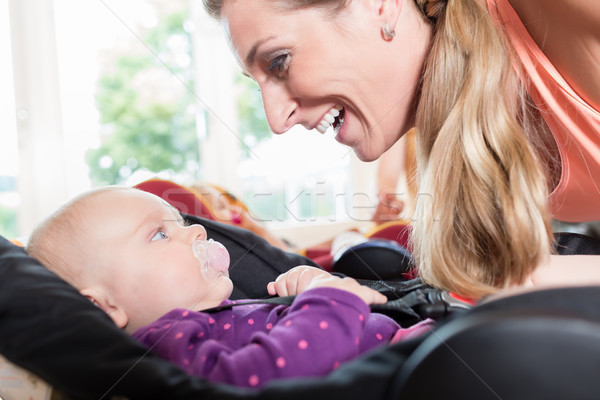 Stock photo: Moms and babies in mother and child course practicing
