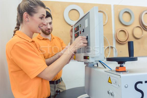 Team of carpenters programming CNC machine in their workshop  Stock photo © Kzenon
