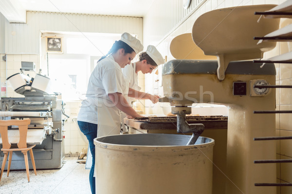 Close-up on baker in bakery forming pretzel bread Stock photo © Kzenon