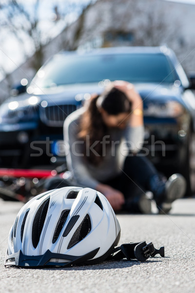 Bicycling helmet on the asphalt after accidental collision Stock photo © Kzenon