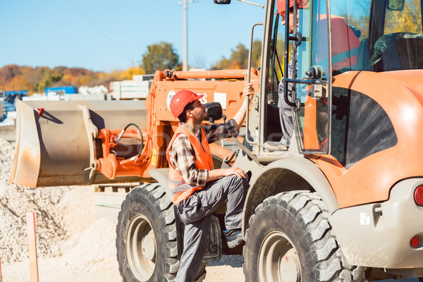 Wheel loader with tip-up bucket on construction site  Stock photo © Kzenon