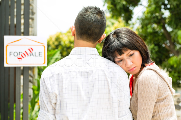 disappointed asian couple in front of a house Stock photo © Kzenon