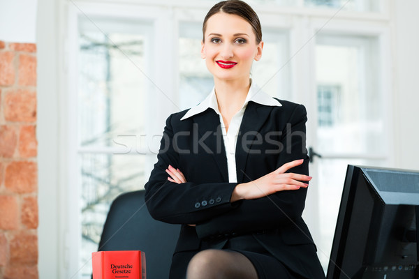 Lawyer in office with law book Stock photo © Kzenon
