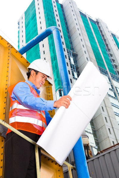 Asian worker or supervisor on building site  Stock photo © Kzenon
