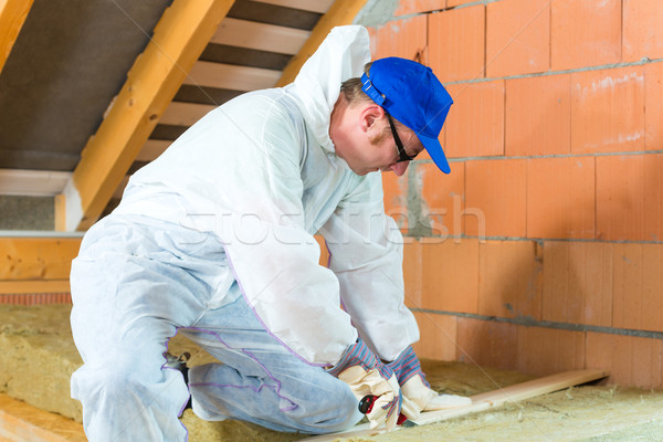 Worker cutting insulating material Stock photo © Kzenon