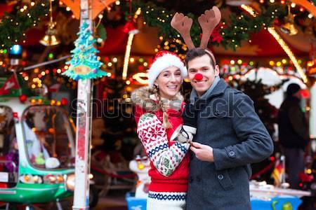 Friends drinking spiced wine on Christmas market Stock photo © Kzenon