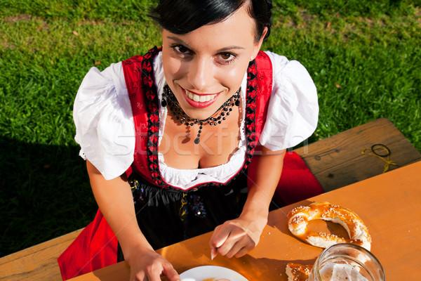 Woman in Dirndl drinking beer Stock photo © Kzenon